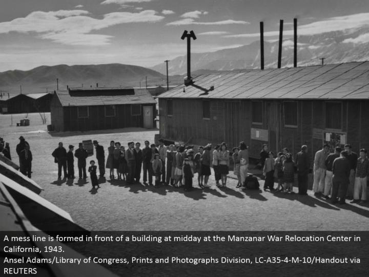 A chaos line is shaped before a working at late morning at the Manzanar War Relocation Center in California, 1943. Ansel Adams/Library of Congress, Prints and Photographs Division, LC-A35-4-M-10/Handout by means of REUTERS