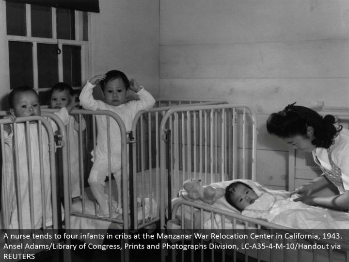 A medical attendant tends to four babies in dens at the Manzanar War Relocation Center in California, 1943. Ansel Adams/Library of Congress, Prints and Photographs Division, LC-A35-4-M-10/Handout by means of REUTERS