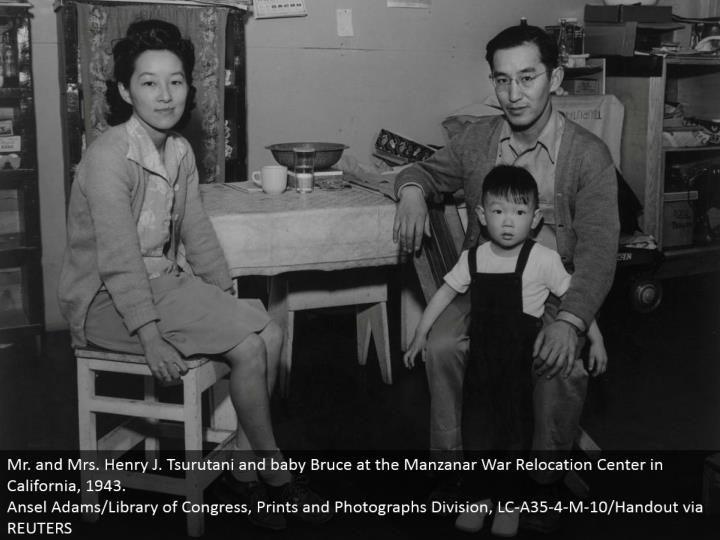 Mr. what's more, Mrs. Henry J. Tsurutani and child Bruce at the Manzanar War Relocation Center in California, 1943. Ansel Adams/Library of Congress, Prints and Photographs Division, LC-A35-4-M-10/Handout by means of REUTERS