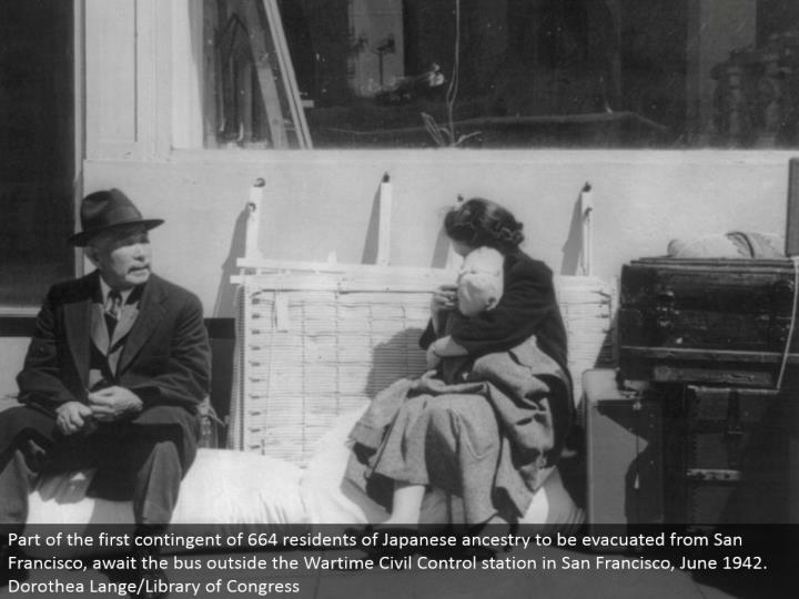 Part of the primary unexpected of 664 occupants of Japanese lineage to be emptied from San Francisco, anticipate the transport outside the Wartime Civil Control station in San Francisco, June 1942. Dorothea Lange/Library of Congress
