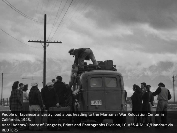 People of Japanese family line stack a transport going to the Manzanar War Relocation Center in California, 1943. Ansel Adams/Library of Congress, Prints and Photographs Division, LC-A35-4-M-10/Handout by means of REUTERS