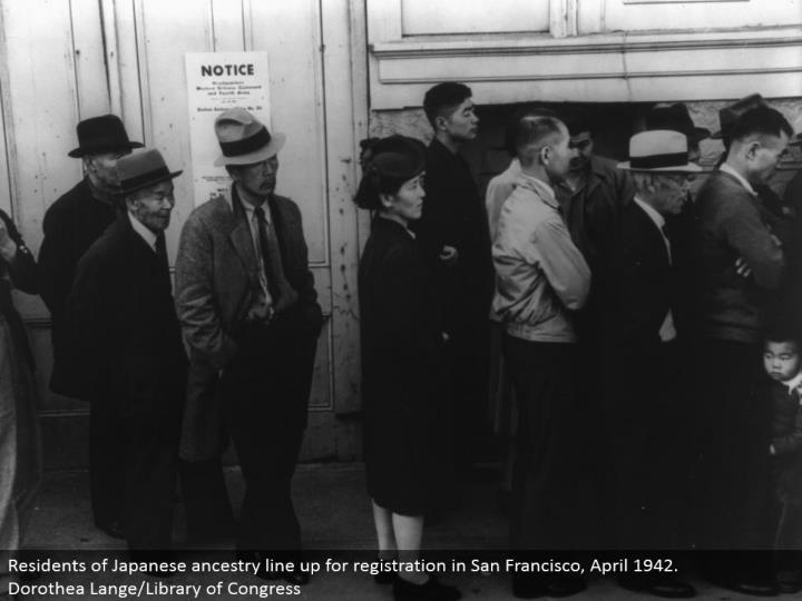 Residents of Japanese lineage line up for enrollment in San Francisco, April 1942. Dorothea Lange/Library of Congress