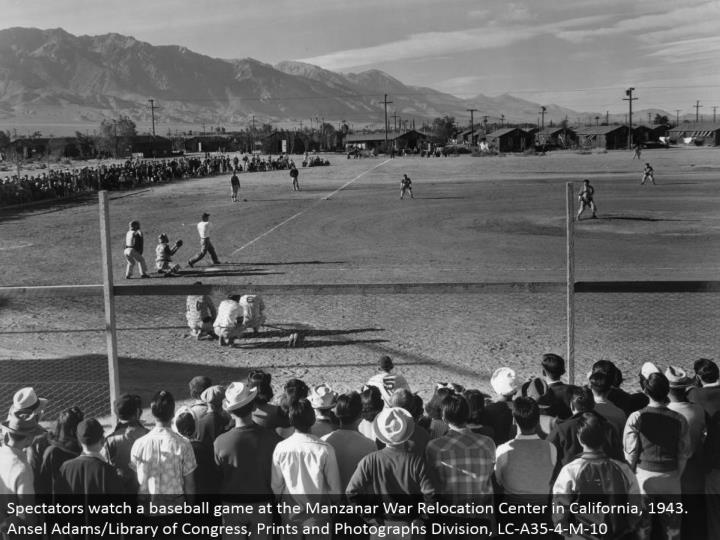 Spectators watch a ball game at the Manzanar War Relocation Center in California, 1943. Ansel Adams/Library of Congress, Prints and Photographs Division, LC-A35-4-M-10