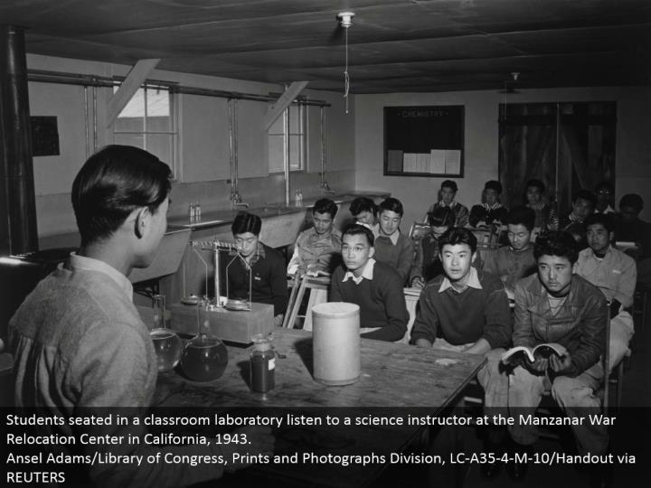 Students situated in a classroom research facility tune in to a science teacher at the Manzanar War Relocation Center in California, 1943. Ansel Adams/Library of Congress, Prints and Photographs Division, LC-A35-4-M-10/Handout by means of REUTERS