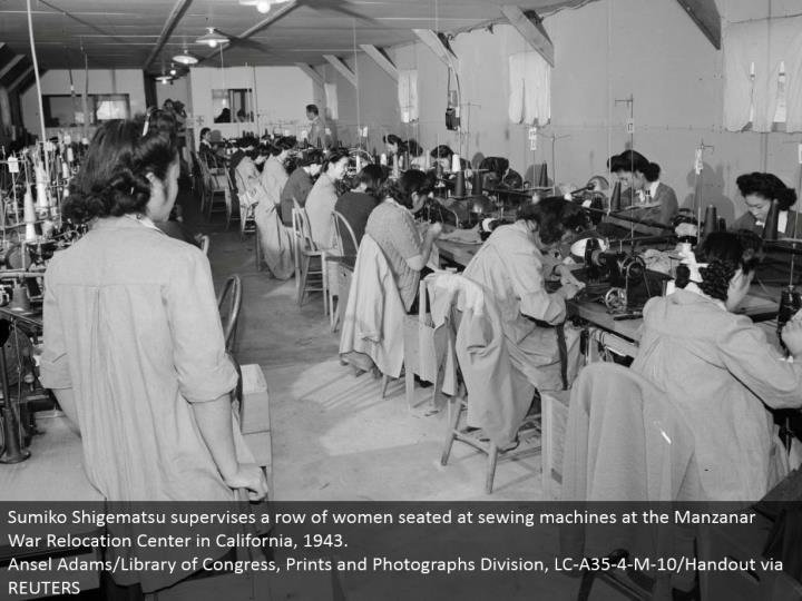 Sumiko Shigematsu manages a column of ladies situated at sewing machines at the Manzanar War Relocation Center in California, 1943. Ansel Adams/Library of Congress, Prints and Photographs Division, LC-A35-4-M-10/Handout by means of REUTERS