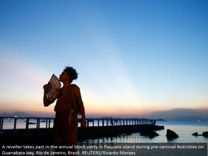 A reveler participates in the yearly piece party in Paqueta island amid pre-jubilee merriments on Guanabara cove, Rio de Janeiro, Brazil. REUTERS/Ricardo Moraes