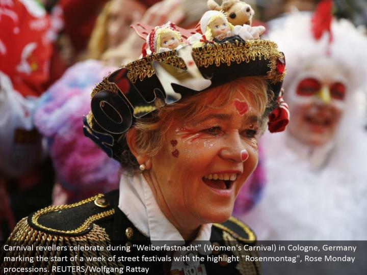 "Carnival revelers celebrate amid ""Weiberfastnacht"" (Women's Carnival) in Cologne, Germany denoting the begin of seven days of road celebrations with the highlight ""Rosenmontag"", Rose Monday parades. REUTERS/Wolfgang Rattay"