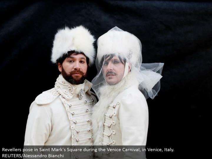 Revellers posture in Saint Mark's Square amid the Venice Carnival, in Venice, Italy. REUTERS/Alessandro Bianchi