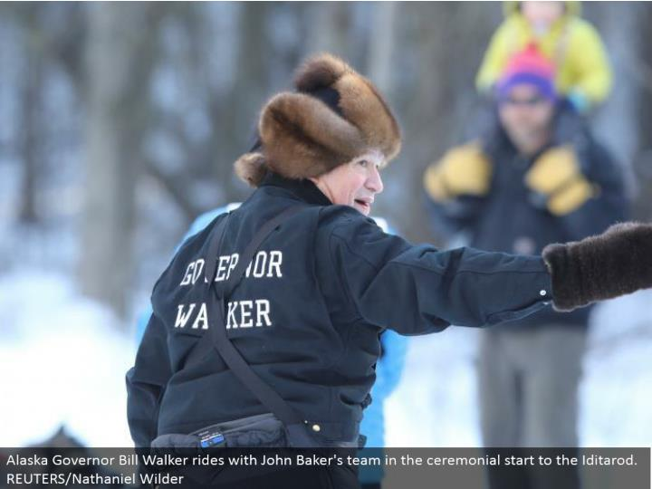 Alaska Governor Bill Walker rides with John Baker's group in the stately begin to the Iditarod. REUTERS/Nathaniel Wilder
