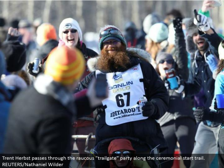 """Trent Herbst goes through the rambunctious """"trailgate"""" party along the stately begin trail. REUTERS/Nathaniel Wilder"""