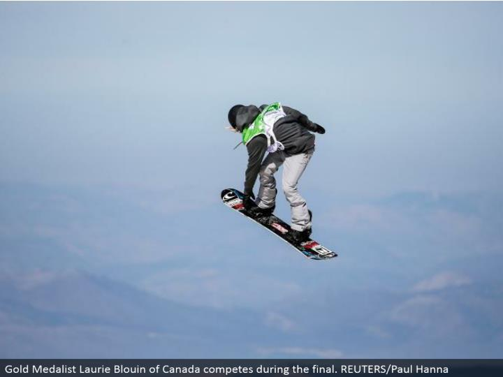Gold Medalist Laurie Blouin of Canada contends amid the last. REUTERS/Paul Hanna