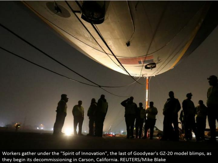"Workers assemble under the ""Soul of Innovation"", the remainder of Goodyear's GZ-20 display dirigibles, as they start its decommissioning in Carson, California. REUTERS/Mike Blake"