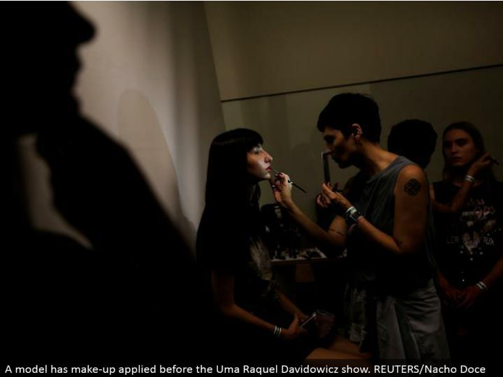 A demonstrate has make-up connected before the Uma Raquel Davidowicz appear. REUTERS/Nacho Doce