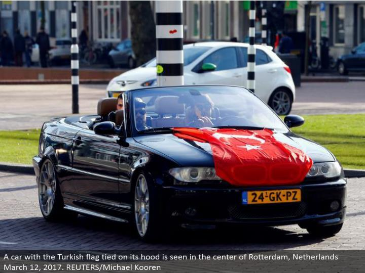 A auto with the Turkish banner tied on its hood is found in the focal point of Rotterdam, Netherlands March 12, 2017. REUTERS/Michael Kooren