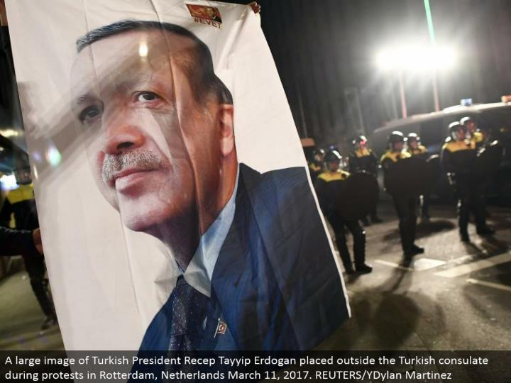 A substantial picture of Turkish President Recep Tayyip Erdogan set outside the Turkish office amid dissents in Rotterdam, Netherlands March 11, 2017. REUTERS/YDylan Martinez