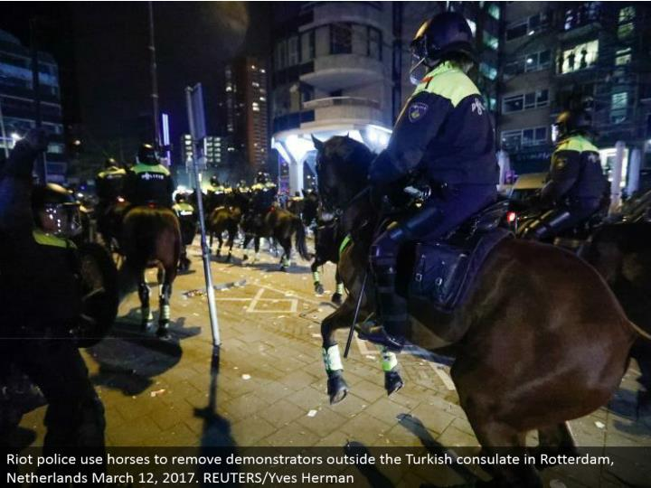 Riot police utilize steeds to expel demonstrators outside the Turkish office in Rotterdam, Netherlands March 12, 2017. REUTERS/Yves Herman