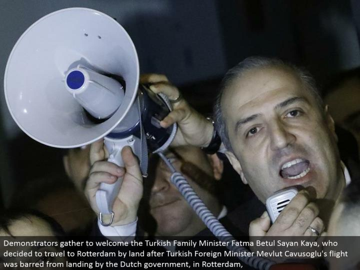 Turkey's represetative to the Netherlands Sadik Arslan addresses swarms outside the Turkish department in Rotterdam, Netherlands March 11, 2017. REUTERS/Yves Herman