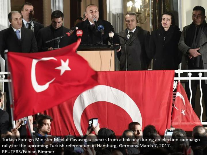 Turkish Foreign Minister Mevlut Cavusoglu talks from an overhang amid a decision battle rally for the up and coming Turkish submission in Hamburg, Germany March 7, 2017. REUTERS/Fabian Bimmer