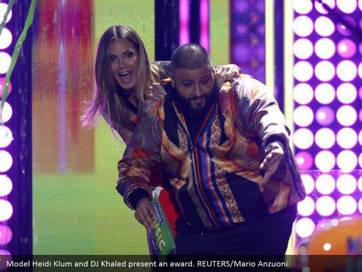 Model Heidi Klum and DJ Khaled display a honor. REUTERS/Mario Anzuoni