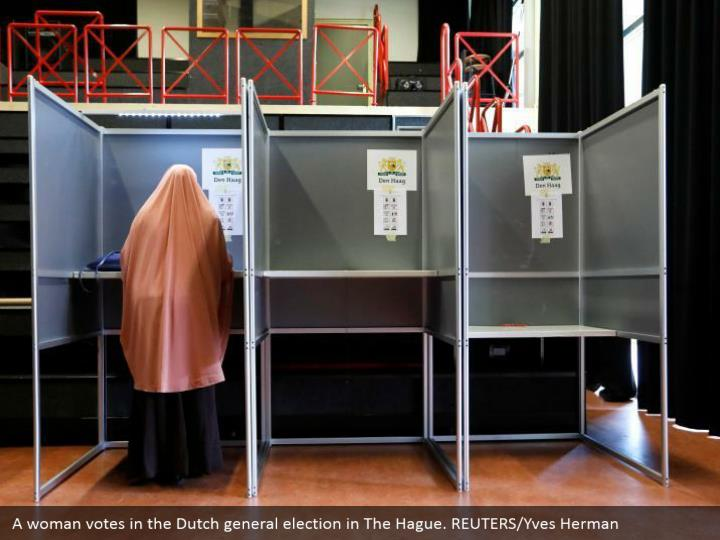 A lady votes in the Dutch general decision in The Hague. REUTERS/Yves Herman