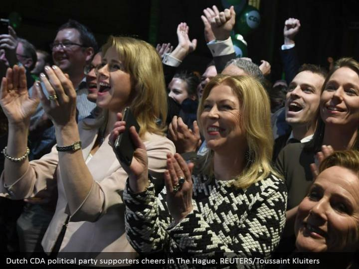 Dutch CDA political gathering supporters cheers in The Hague. REUTERS/Toussaint Kluiters