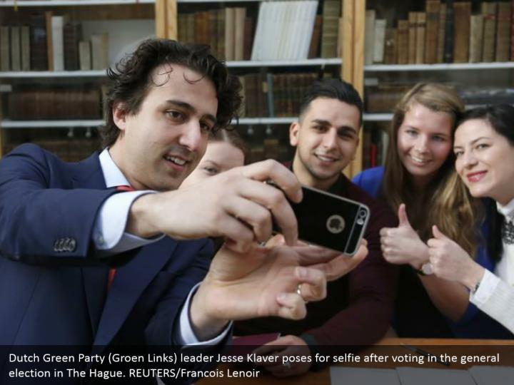 Dutch Green Party (Groen Links) pioneer Jesse Klaver postures for selfie in the wake of voting in the general race in The Hague. REUTERS/Francois Lenoir