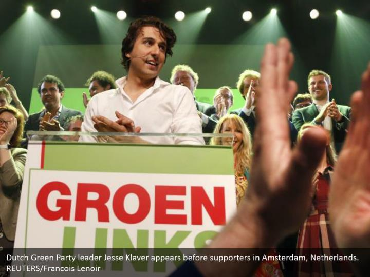 Dutch Green Party pioneer Jesse Klaver shows up before supporters in Amsterdam, Netherlands. REUTERS/Francois Lenoir