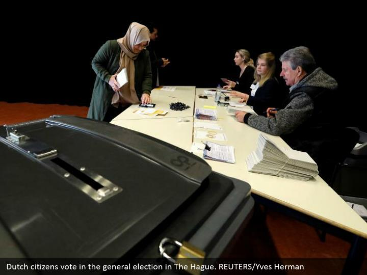 Dutch nationals vote in the general decision in The Hague. REUTERS/Yves Herman