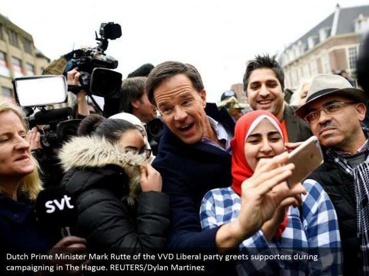 Dutch Prime Minister Mark Rutte of the VVD Liberal gathering welcomes supporters amid battling in The Hague. REUTERS/Dylan Martinez