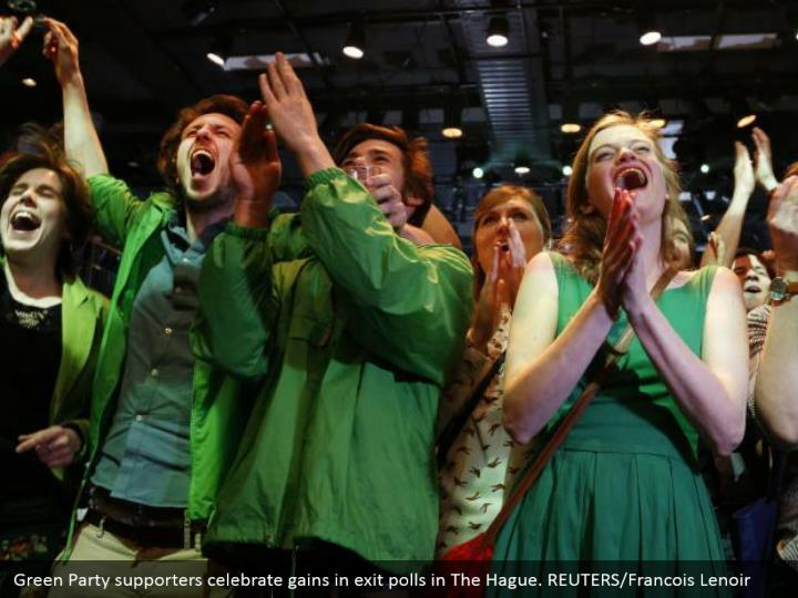 Green Party supporters commend picks up in leave surveys in The Hague. REUTERS/Francois Lenoir