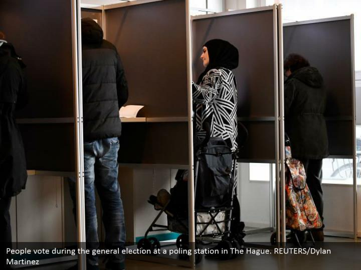 People vote amid the general race at a poling station in The Hague. REUTERS/Dylan Martinez