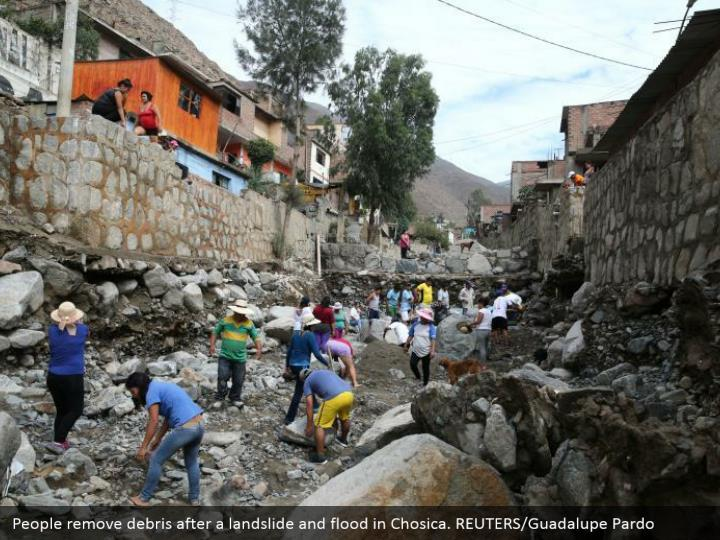 People evacuate flotsam and jetsam after an avalanche and surge in Chosica. REUTERS/Guadalupe Pardo