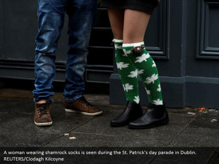 A lady wearing shamrock socks is seen amid the St. Patrick's day parade in Dublin. REUTERS/Clodagh Kilcoyne