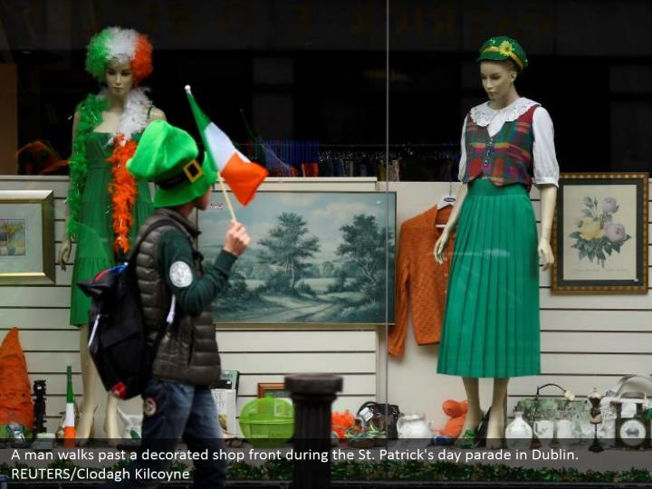 A man strolls past a designed shop front amid the St. Patrick's day parade in Dublin. REUTERS/Clodagh Kilcoyne