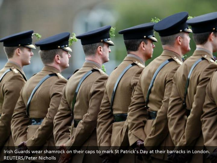 Irish Guards wear shamrock on their tops to check St Patrick's Day at their military enclosure in London. REUTERS/Peter Nicholls