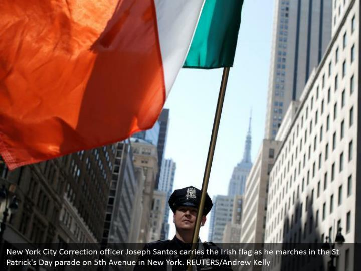 New York City Correction officer Joseph Santos conveys the Irish banner as he walks in the St Patrick's Day parade on fifth Avenue in New York. REUTERS/Andrew Kelly
