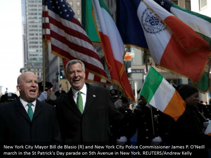 New York City Mayor Bill de Blasio (R) and New York City Police Commissioner James P. O'Neill walk in the St Patrick's Day parade on fifth Avenue in New York. REUTERS/Andrew Kelly