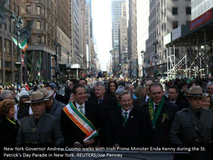 New York Governor Andrew Cuomo strolls with Irish Prime Minister Enda Kenny amid the St. Patrick's Day Parade in New York. REUTERS/Joe Penney
