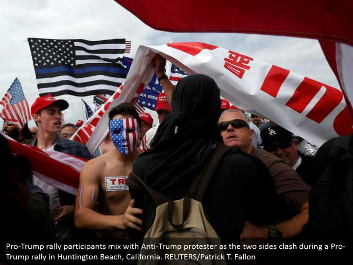 Pro-Trump rally participants mix with Anti-Trump protester as the two sides clash during a Pro-Trump rally in Huntington Beach, California. REUTERS/Patrick T. Fallon