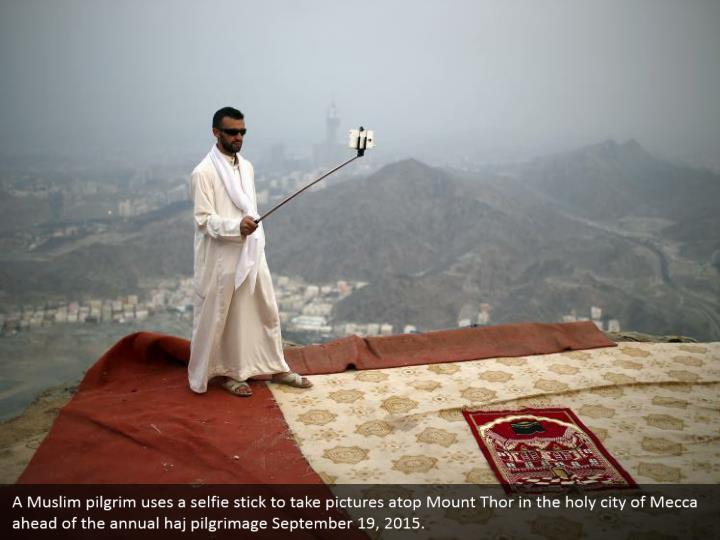 A Muslim pilgrim uses a selfie stick to take pictures atop Mount Thor in the holy city of Mecca ahead of the annual haj pilgrimage September 19, 2015.