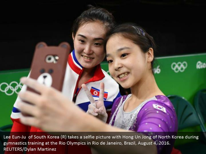 Lee Eun-Ju  of South Korea (R) takes a selfie picture with Hong Un Jong of North Korea during gymnastics training at the Rio Olympics in Rio de Janeiro, Brazil, August 4, 2016. REUTERS/Dylan Martinez