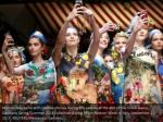 models take selfie with mobile phones during