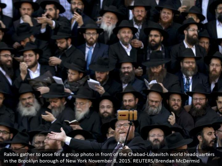 Rabbis gather to pose for a group photo in front of the Chabad-Lubavitch world headquarters in the Brooklyn borough of New York November 8, 2015. REUTERS/Brendan McDermid