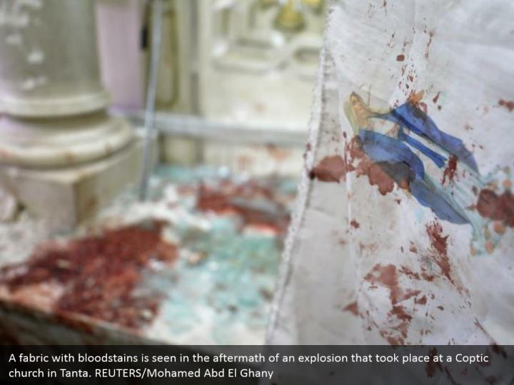 A fabric with bloodstains is seen in the aftermath of an explosion that took place at a Coptic church in Tanta. REUTERS/Mohamed Abd El Ghany