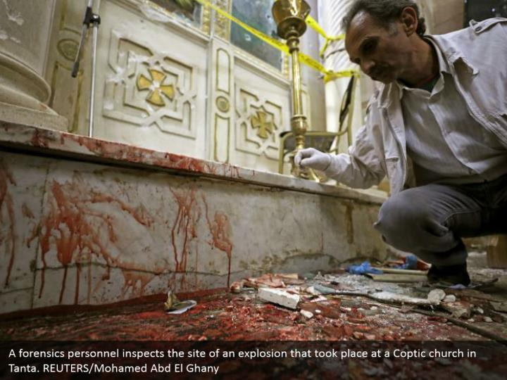 A forensics personnel inspects the site of an explosion that took place at a Coptic church in Tanta. REUTERS/Mohamed Abd El Ghany