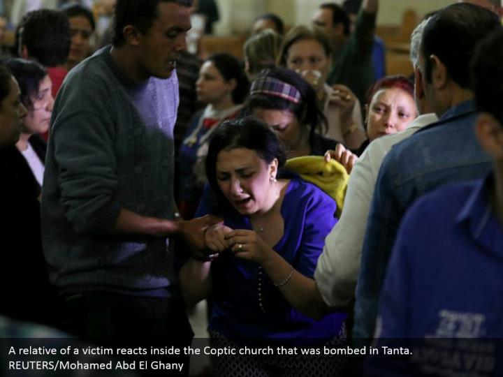 A relative of a victim reacts inside the Coptic church that was bombed in Tanta. REUTERS/Mohamed Abd El Ghany