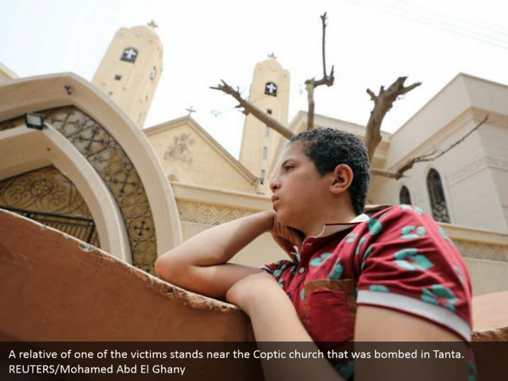 A relative of one of the victims stands near the Coptic church that was bombed in Tanta. REUTERS/Mohamed Abd El Ghany
