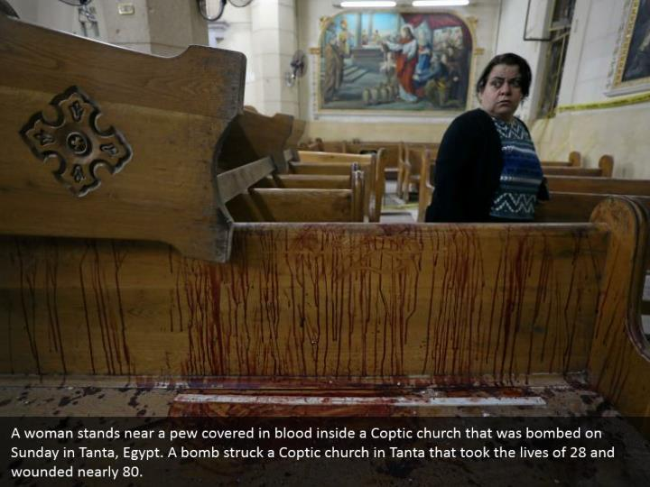 A woman stands near a pew covered in blood inside a Coptic church that was bombed on Sunday in Tanta, Egypt. A bomb struck a Coptic church in Tanta that took the lives of 28 and wounded nearly 80.