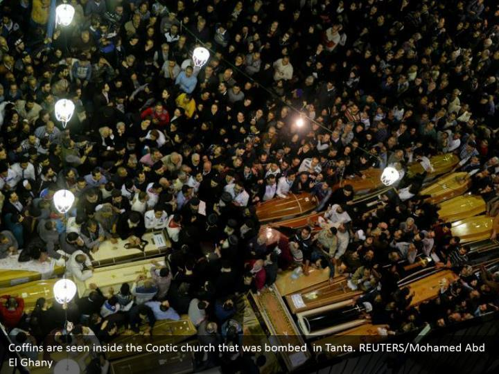 Coffins are seen inside the Coptic church that was bombed  in Tanta. REUTERS/Mohamed Abd El Ghany