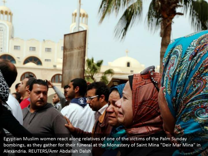 """Egyptian Muslim women react along relatives of one of the victims of the Palm Sunday bombings, as they gather for their funeral at the Monastery of Saint Mina """"Deir Mar Mina"""" in Alexandria. REUTERS/Amr Abdallah Dalsh"""